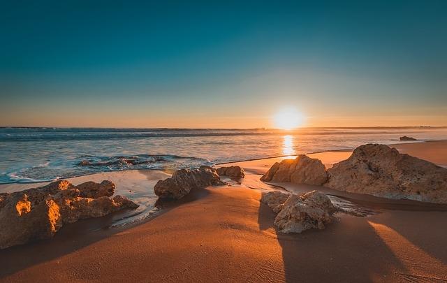 Vakantie Portugal zonsondergang strand